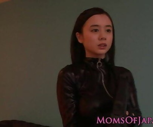 Costumed asian mother in..
